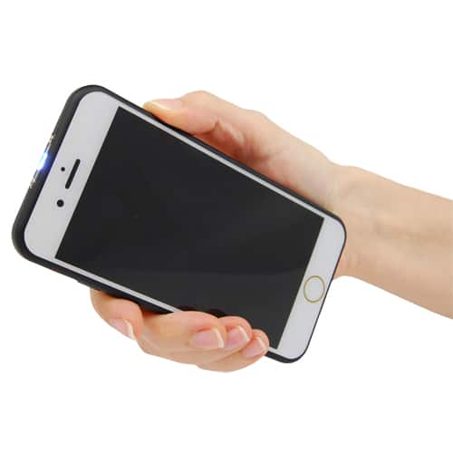 Cell phone image held in hand front side showing.