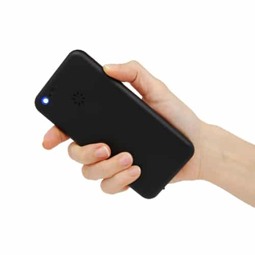 Cell phone image held in hand back side showing